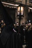Nazarene con la vela en la noche Imagen de archivo libre de regalías