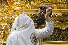 Nazarene that goes with the hand on the manigueta the throne in a procession of holy week Stock Image