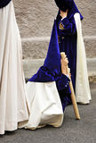 Nazarene tired child in Triana, brotherhood of Hope, Holy Week in Seville, Andalusia, Spain Stock Image