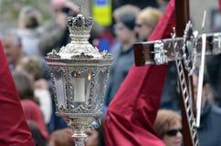 Nazarene wearing silver lantern in easter processi Stock Image