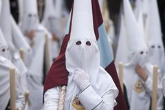 Holy Week in Seville Nazarenes. Nazarenes prepared to make your season of penance in Holy Week Stock Photography