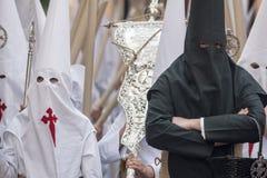 Nazarenessäsong av penitens av brödraskapet av Borriquita, helig vecka i Seville Arkivbild