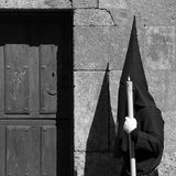 Nazareno by a wood door. A nazareno during a procession in Castilla (Spain Stock Images
