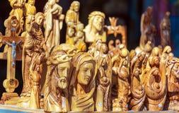 NAZARET, ISRAEL - 21 DE FEBRERO DE 2013: Christian Statues de madera i Imagenes de archivo