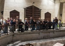 The believers kneel and pray in the Basilica of the Annunciation in the old city of Nazareth in Israel Royalty Free Stock Photos