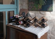 Bottles with wine in a decorative stand in Michel House in the old city of Nazareth in Israel. Nazareth, Israel, December 23, 2017 : Bottles with wine in a Royalty Free Stock Photography