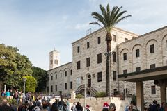 The building of the Museum Of Ancient Nazareth and the bell tower of the St. Joseph`s Church in the old city of Nazareth in Israe. Nazareth, Israel, December 23 stock images