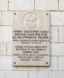 Memorial granite board with inscriptions in Polish and Latin on the St. Joseph`s Church wall in the old city of Nazareth in Israel. Nazareth, Israel, December 23 stock image