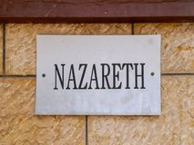 Nazareth sign on a stone Wall. Nazareth sign with black letters on a dirty white board, mounted on a stone wall Royalty Free Stock Photo