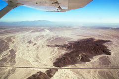 Nazca Lines airplane over desert Royalty Free Stock Photo
