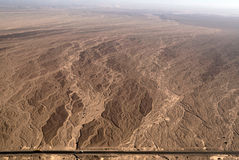 Nazca lines - Dry river bed - aerial view. Flight over Nazca lines - Dry river bed aerial view with a road - Peru Royalty Free Stock Image