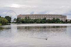 Nazi congrass hall, nurnberg. View of remains of nazi congress hall reflecting in lake under thunderclouds Stock Photography