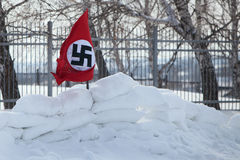 Nazi flag in the snow Royalty Free Stock Images