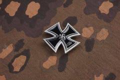 Nazi german award Iron Cross on SS camouflage uniform. Background stock image