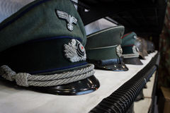 Nazi hats at Militalia 2013 in Milan, Italy Royalty Free Stock Photo