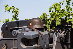 Nazi helmet lies on the gun battle during historical reenactment of WWII Stock Photography