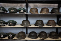 Nazi helmets and hats at Militalia 2013 in Milan, Italy Royalty Free Stock Photos