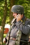Nazi with mobile phone Royalty Free Stock Photos