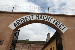 Nazi motto Arbeit Macht Frei in Terezin. Archway with the Nazi motto Arbeit Macht Frei (Work Makes You Free) in the former Gestapo prison in Terezin, Czech Stock Photos