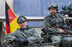 Nazi officer with bodyguard soldier. Stand on combat car with German flag on  May 10, 2014 in Bucharest Royalty Free Stock Photos