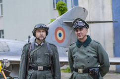 Nazi officer with bodyguard soldier. Standing and airplain in backgrund on  May 10, 2014 in Bucharest Stock Photography