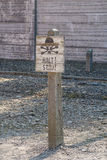 Nazi`s `Halt!` sign post in Auschwitz concentration camp. Poland Stock Images