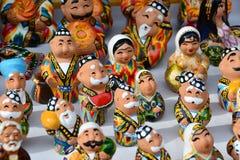 Nazione felice dell'Uzbeco in mini statue Fotografia Stock Libera da Diritti