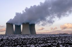 European nuclear power plant in wintertime royalty free stock photo