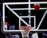NBA Glass backboard. NBA Glass Backboard with the NBA logo on it. (Image taken from the color negative Stock Photography