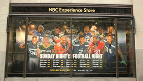 NBC Experience Store window display decorated with NBC and Sunday night Football logos in Rockefeller Center Royalty Free Stock Photo