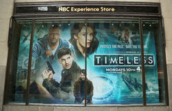 NBC Experience Store window display decorated with Timeless television event logo in Rockefeller Center Stock Photography