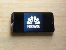 NBC News app. On smartphone kept on wooden table royalty free stock photos