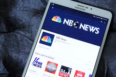 Nbc news channel app logo. Downloading nbc news channel application from google play store on samsung tab s2 royalty free stock photography