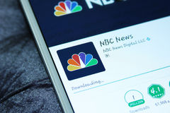 NBC news mobile app. Downloading NBC news mobile application from google play store on samsung tablet stock photo