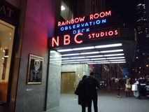 NBC Studios, Rainbow Room, Observation Deck, 30 Rockefeller Plaza, NYC, USA. Iconic New York City Landmarks: 30 Rockefeller Plaza 30 Rock: Enter under this neon Royalty Free Stock Photos
