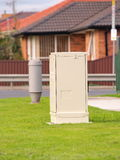 NBN fiber cabinet besides old copper telephone cable pillar Royalty Free Stock Photos