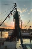 NC.USA. Boat silhouette. Picturesque sunset on river. Vertical photo. stock image