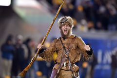 2014 NCAA橄榄球行动- WVU堪萨斯状态 免版税库存图片