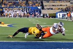 2015 NCAA橄榄球-在西维吉尼亚的俄克拉何马状态 库存照片