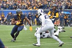 2014 NCAA橄榄球- TCU-WVU 免版税库存照片