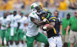 NCAA 2012 - WVU-Marshall action Stock Images