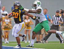 NCAA 2012 - WVU-Marshall action Royalty Free Stock Images