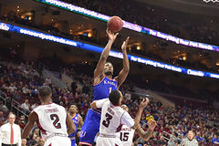 2014 NCAA Basketball - Kansas at Temple. PHILADELPHIA - DECEMBER 22: Kansas Jayhawks guard Wayne Selden Jr. (1) puts up a shot over Temple Owls guard Jesse Stock Photography
