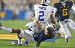 2014 NCAA Football action - WVU-Kansas State Royalty Free Stock Photography