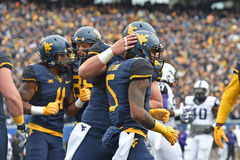 2014 NCAA Football - TCU-WVU. MORGANTOWN, WV - November 1: WVU receiver Mario Alford (5) is congratulated by teammates after a first quarter touchdown catch Stock Photo