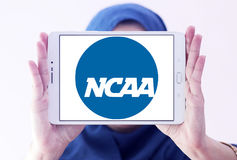 Ncaa logo. Logo of american ncaa, National Collegiate Athletic Association, on samsung tablet holded by arab muslim woman Stock Photography