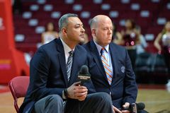 2015 NCAA Men's Basketball - Temple-Houston. PHILADELPHIA - FEBRUARY 26:  CBS broadcasters  Alaa Abdelnaby  (fore) and Tom McCarthy prepare to provide a pre game Stock Photos