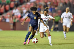 2015 NCAA Women's Soccer - WVU-Maryland. COLLEGE PARK, MD - AUGUST 28: West Virginia Amandine Pierre-Louise (11) works the ball upfield during the NCAA women's Royalty Free Stock Image