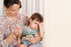 Nce mom  feeding her daughter Royalty Free Stock Photography