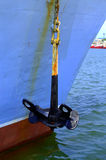 Аnchor. Anchor hanging from rusty chain on a old docked shipboard Stock Photography
